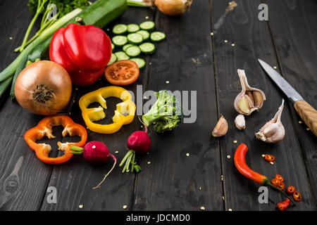 Close-up view of fresh seasonal vegetables on rustic wooden background - Stock Photo