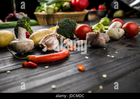 Close-up view of fresh seasonal vegetables on wooden table background - Stock Photo