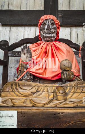 Wooden statue of a seated Binzuru (PIndola Bharadvja) outside the Daibutsuden (Great Buddha Hall) at Todai-ji (Eastern - Stock Photo