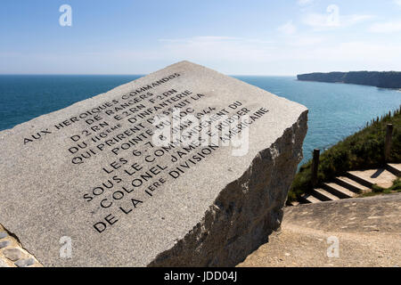 Inscription and the View Along the Cliffs From the Ranger Memorial on the Pointe Du Hoc, Normandy, France - Stock Photo