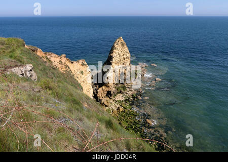 Barbed Wire and the Pointe Du Hoc, Normandy, France - Stock Photo