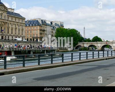 Tourist boat cruising on River Seine past Parc Rives de Seine, Paris, France - Stock Photo