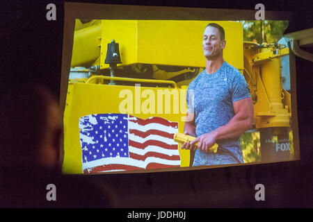 Merrick, New York, USA. 11th June, 2017. JOHN CENA, American Grit star, appears in scene projected on large TV screen - Stock Photo
