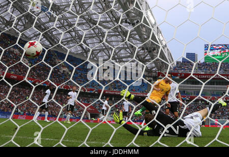 Sochi, Russia. 19th June, 2017. Tomi Juric (9) of Australia scores during the group B match between Australia and - Stock Photo