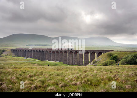 Ingleborough, UK. 20th Jun, 2017. On an overcast Summer's day, The Dalesman steam excursion crosses Batty Moss (or - Stock Photo
