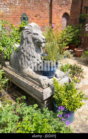 Elegant Large Garden Ornaments Including Lion Statues And Pots In An Ornate English  Garden, Kent England