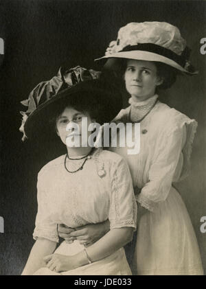 Antique c1910 photograph, mother and daugher in Edwardian clothing. Location is probably Mankato, Minnesota. SOURCE: - Stock Photo