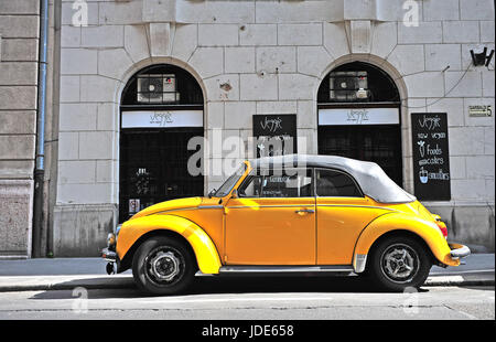 BUDAPEST, HUNGARY - MAY 29: Yellow retro Volkswagen beetle car in in street of Budapest on May 29, 2016. - Stock Photo