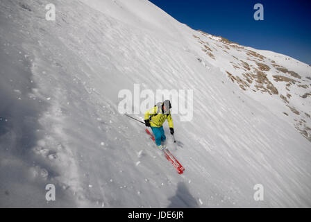 Skier off piste on the back of the Grand Monte, heading for the Argentiere Glacier - Stock Photo