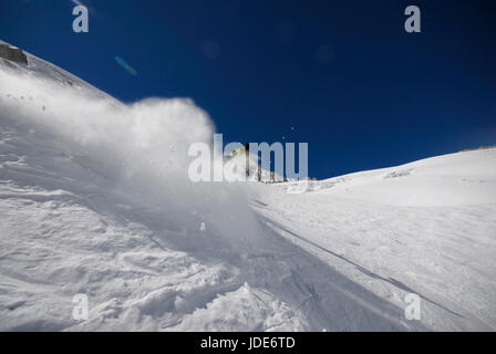 Lone skier off piste on the back of the Grand Monte descending to the Argenetiere glacier - Stock Photo