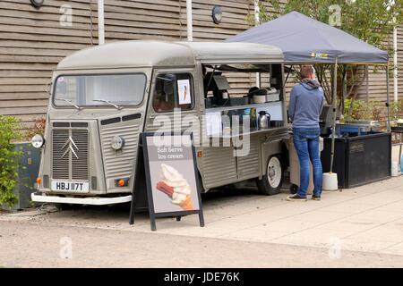 Wisley, Surrey, UK - April 30 2017: Vendor serving hot food to a customer - Stock Photo