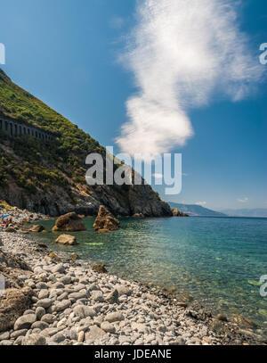Rocky coastline along 'Costa Viola' near Palmi, in Calabria region (southern Italy) - Stock Photo
