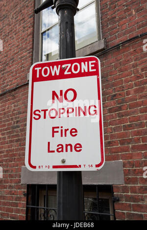 sign for tow zone no stopping fire lane in historic downtown Boston USA - Stock Photo