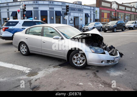 accident damaged car immobilised due to crash at intersection in suburbs of Boston USA - Stock Photo