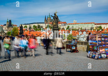 Crowds of tourists and stalls selling souvenirs on Charles Bridge, Prague, Bohemia, Czech Republic - Stock Photo