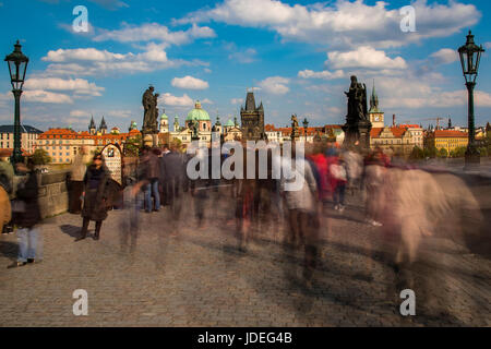 Crowds of tourists on Charles Bridge, Prague, Bohemia, Czech Republic - Stock Photo