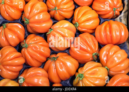 Beefsteak tomatoes for sale at a market - Stock Photo