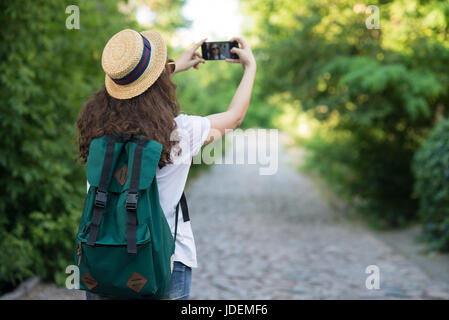 Traveler using smartphone camera to take selfie or shooting street - Stock Photo