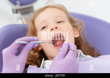 Close-up little girl at dentist - Stock Photo