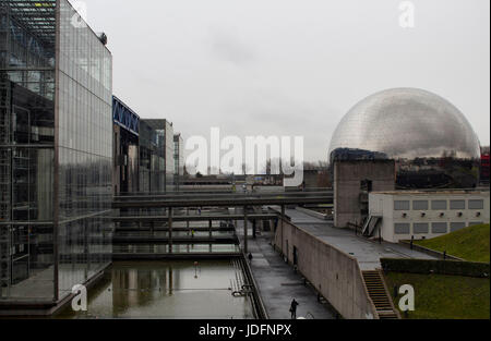 View of City of Science and Industry in Paris winter time. La Geode (modern cinema inside a mirror ball) is also - Stock Photo