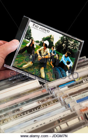 Urban Hymns, The Verve CD being chosen from among rows of other CD's, Dorset, England - Stock Photo