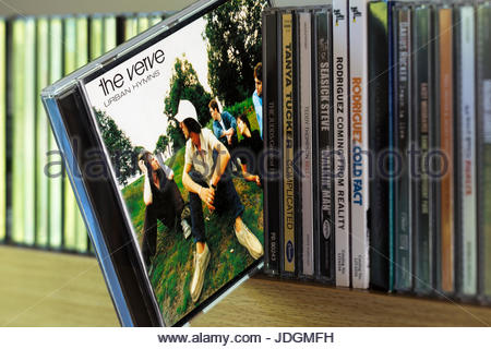 Urban Hymns, The Verve CD pulled out from among other CD's on a shelf, Dorset, England - Stock Photo