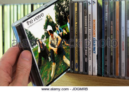 Urban Hymns, The Verve CD being chosen from a shelf of other CD's, Dorset, England - Stock Photo