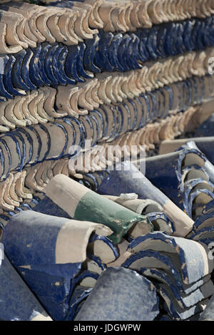 Abstract pattern of freshly made blue and green tiles lie outside the factory near Fez in Morocco - Stock Photo