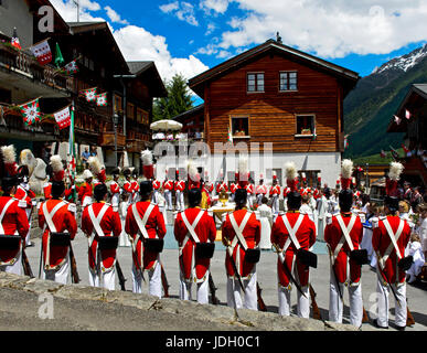 Grenadiers of the Lord at the Corpus Christi mass on the village square, Wiler, Loetschental, Valais Switzerland - Stock Photo