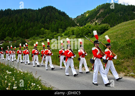 Grenadiers of Our Lord at the Corpus Christi procession, Wiler, Lötschental, Valais, Switzerland - Stock Photo