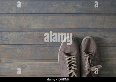 Sneakers on dark floor - Stock Photo