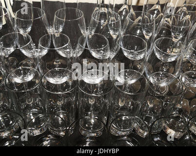 Wine and cocktail glasses on black tablecloth - Stock Photo