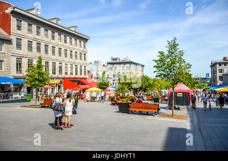 Montreal, Canada - June 15, 2017: Tourists on Jacques Cartier place.Place Jacques-Cartier is a square located in - Stock Photo