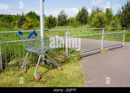 An abandoned shopping trolley at Barnstaple, North Devon, England. - Stock Photo