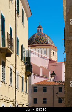 Alghero old town, view of the San Michele church with its famous majolica-tiled dome in the old town area of Alghero, - Stock Photo