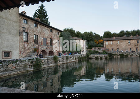 BAGNO VIGNONI, TUSCANY ITALY - October 30, 2016: Undefined people in the old thermal baths in the medieval village - Stock Photo