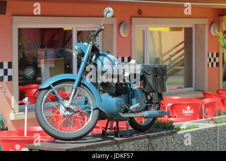 Vernayaz, Martigny, Switzerland. Old motorcycle in interior of Joe Bar Team cafe