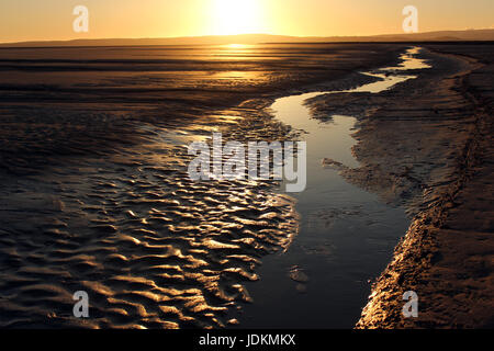 The beach at sunset at Grange-over-Sands in the parish of Lower Holker very near to the Lake District. It is a tidal - Stock Photo
