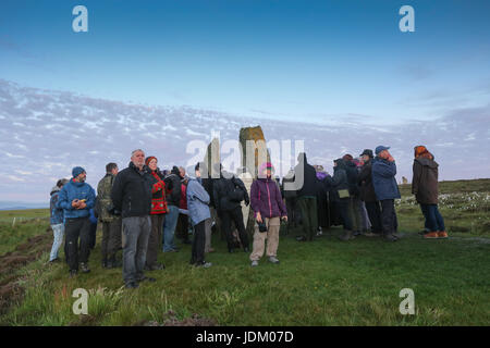 People waiting and watching for the sunrise on the summer solstice at Ring of Brodgar, Orkney Scotland UK - Stock Photo
