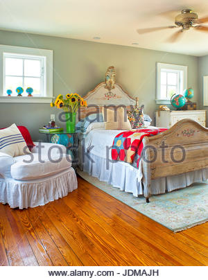 Country home bedroom with sunflowers and colorful quilt Stock ... : country home quilts - Adamdwight.com