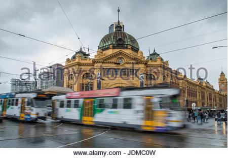 Flinders Street Station in Melbourne in rain. - Stock Photo