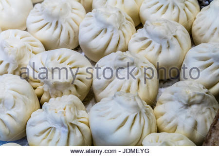 Chinese meat and rice filled dumplings at a food stall. - Stock Photo