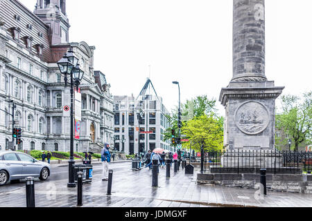 Montreal, Canada - May 26, 2017: Nelson's column in Quebec region with people walking in rainy cloudy wet day - Stock Photo