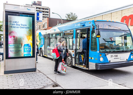 Montreal, Canada - May 26, 2017: Novabus bus in city in Quebec region with people getting on - Stock Photo