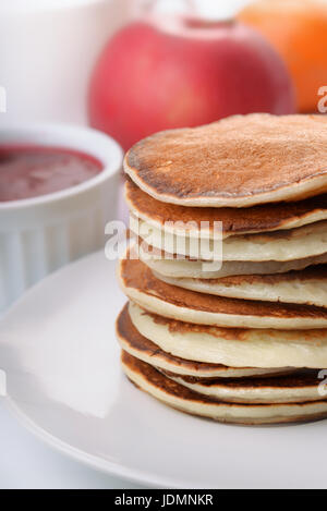 Stack of fresh pancakes with fruit and jam - Stock Photo