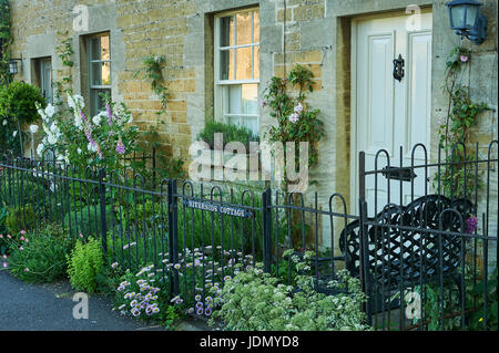 Stone cottages in the pretty Cotswold village of Lower Slaughter - Stock Photo