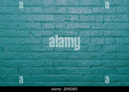 Vintage texture of old brick wall dyed in turquoise color. Painted facade of apartment house - Stock Photo
