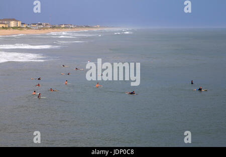 Surfers in Atlantic Ocean at Nags Head Beach Outer Banks North Carolina - Stock Photo