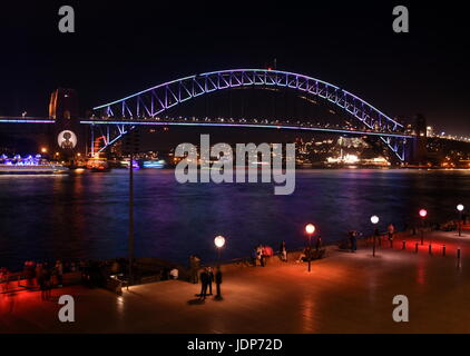 Harbour Bridge from Opera House during Sydney Vivid Light Festival. Harbour Bridge is one of the most famous landmarks - Stock Photo