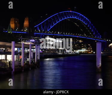 Harbour Bridge from Circular Quay during Sydney Vivid Light Festival. Harbour Bridge is one of the most famous landmarks - Stock Photo